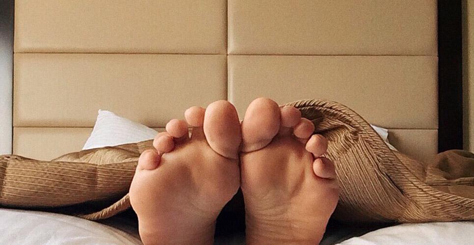 Sleeping feet under protective blanket