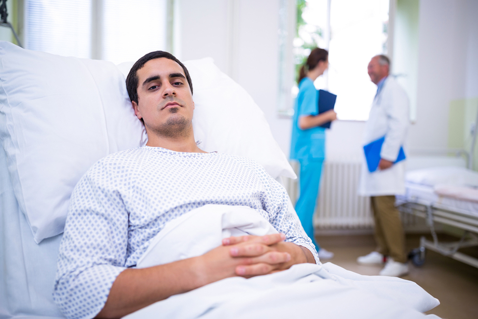 Ill patient lying on bed in hospital