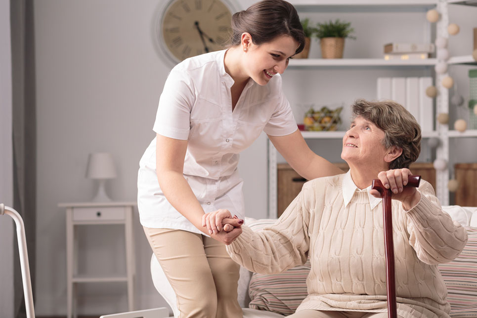 caregiver looking after elderly woman