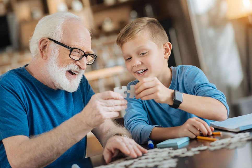 grandfather and grandson work on puzzle
