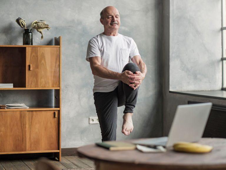 senior man stretching in yoga pose