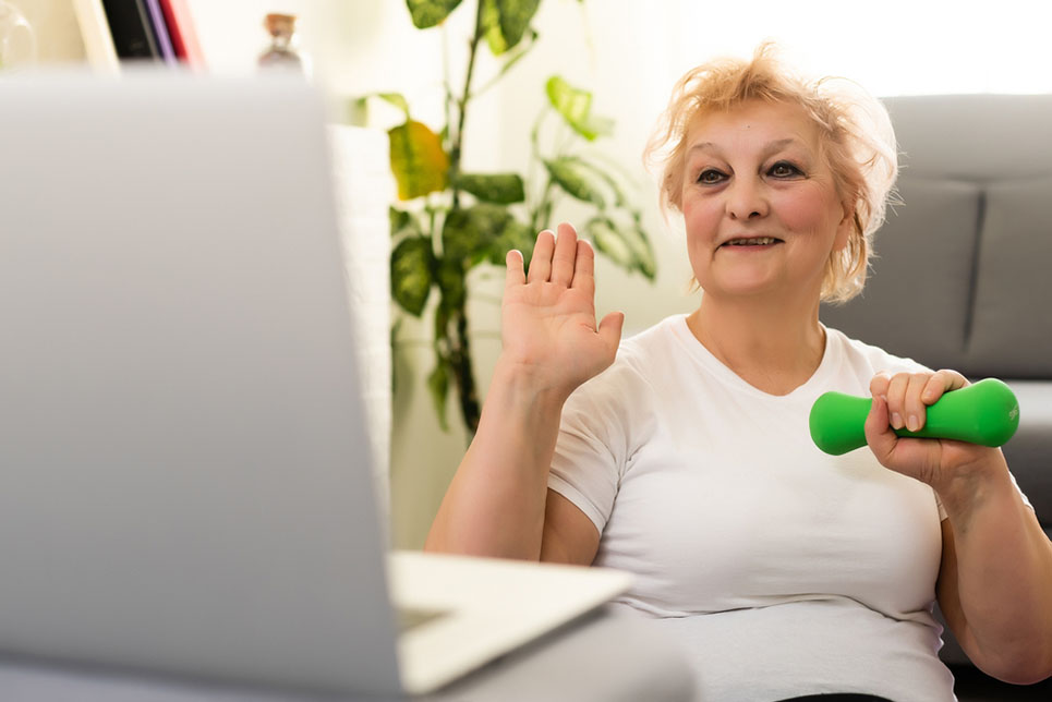 woman lifting weight with computer