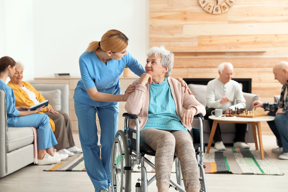 nurses assisting elderly people