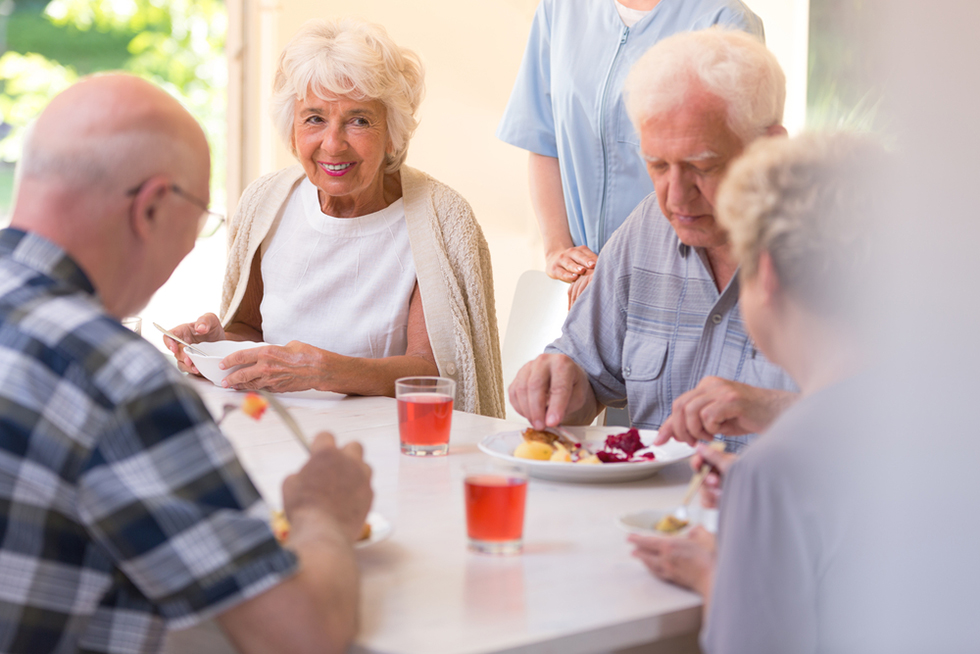 a group of seniors having lunch together
